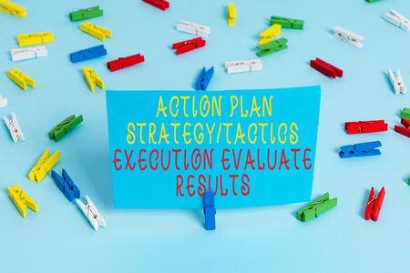 Handwriting text Action Plan Strategy Ortacti. Conceptual photo Action Plan Strategy Or Tactics Execution Evaluate Results Colored clothespin papers empty reminder blue floor background office pin Stockfoto