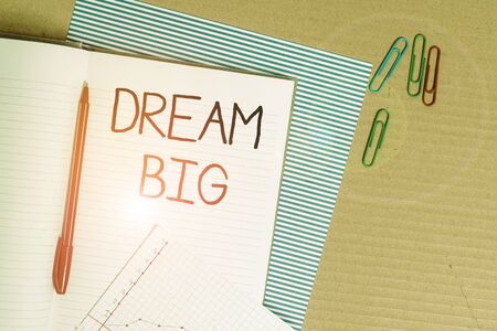 Writing note showing Dream Big. Business concept for To think of something high value that you want to achieve Striped paperboard notebook cardboard office study supplies chart paper