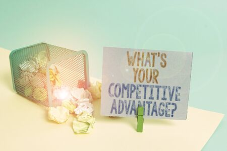 Word writing text What S Your Competitive Advantage Question. Business photo showcasing Marketing strategy Plan Trash bin crumpled paper clothespin empty reminder office supplies tipped