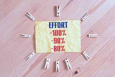 Writing note showing Effort 100 Percent 90 Percent 80 Percent. Business concept for Level of determination discipline motivation Colored clothespin papers empty reminder wooden floor background office