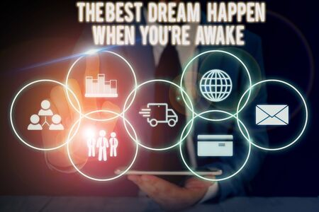 Conceptual hand writing showing The Best Dream Happen When You Re Awake. Concept meaning Dreams come true Have to believe Male wear formal suit presenting presentation smart device Stok Fotoğraf