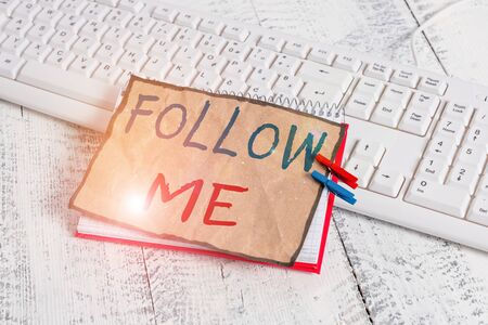 Text sign showing Follow Me. Business photo text Inviting a demonstrating or group to obey your prefered leadership notebook paper reminder clothespin pinned sheet white keyboard light wooden