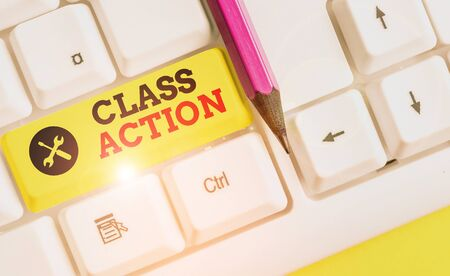 Handwriting text Class Action. Conceptual photo lawsuit filed by small group acting on behalf of a large group White pc keyboard with empty note paper above white background key copy space