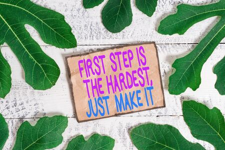 Writing note showing First Step Is The Hardest Just Make It. Business concept for dont give up on final route Standard-Bild