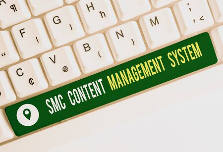 Text sign showing Smc Content Management System. Business photo text analysisgae creation and modification of posts White pc keyboard with empty note paper above white background key copy space