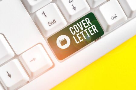 Writing note showing Cover Letter. Business concept for document explaining the applicant s is credentials and interest White pc keyboard with note paper above the white background