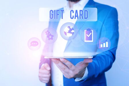 Text sign showing Gift Card. Business photo text A present usually made of paper that contains your message Male human wear formal work suit presenting presentation using smart device Stok Fotoğraf