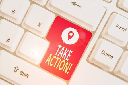 Writing note showing Take Action. Business concept for do something official or concerted to achieve aim with problem White pc keyboard with note paper above the white background Stok Fotoğraf