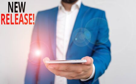 Word writing text New Release. Business photo showcasing announcing something newsworthy recent product Business concept with man holding mobile phone with touch screen