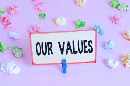 Conceptual hand writing showing Our Values. Concept meaning list of morals companies or individuals commit to do them Colored crumpled papers empty reminder pink floor clothespin Stok Fotoğraf