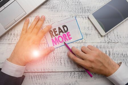 Writing note showing Read More. Business concept for Provide more time or thorough reading for a specific topic or item