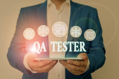 Writing note showing Qa Tester. Business concept for Quality assurance of an on going project before implementation Male wear formal work suit presenting presentation smart device
