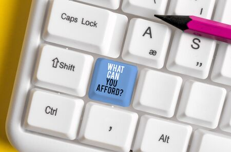 Conceptual hand writing showing What Can You Afford Question. Concept meaning Give us your budget availability of money White pc keyboard with note paper above the white background