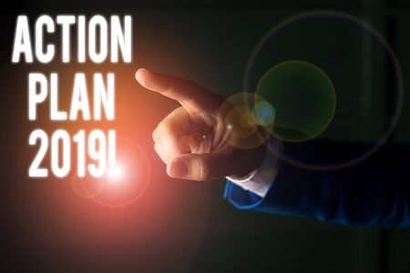 Word writing text Action Plan 2019. Business photo showcasing proposed strategy or course of actions for current year Isolated hand pointing with finger. Business concept pointing finger Stok Fotoğraf
