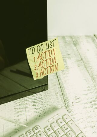 Word writing text To Do List 1Action 2Action 3Action. Business photo showcasing putting day priorities in order Notation paper taped to black computer monitor screen near white keyboard