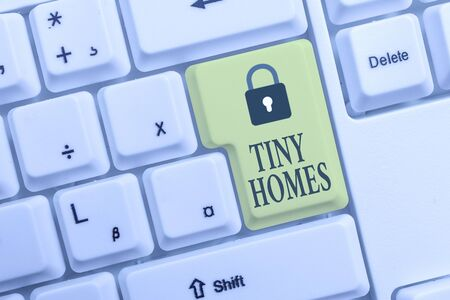 Text sign showing Tiny Homes. Business photo text houses contain one room only or two and small entrance Cheap White pc keyboard with empty note paper above white background key copy space