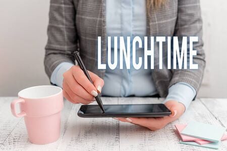 Writing note showing Lunchtime. Business concept for Meal in the middle of the day after breakfast and before dinner Business woman sitting with mobile phone and cup of coffee on the table