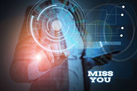 Word writing text Miss You. Business photo showcasing Longing for an important demonstrating in your life for a period of time Woman wear formal work suit presenting presentation using smart device Banco de Imagens