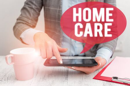 Text sign showing Home Care. Business photo showcasing Place where showing can get the best service of comfort rendered Business woman sitting with mobile phone and cup of coffee on the table