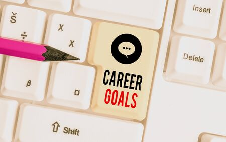 Writing note showing Career Goals. Business concept for profession that an individual intends to pursue in his career White pc keyboard with note paper above the white background