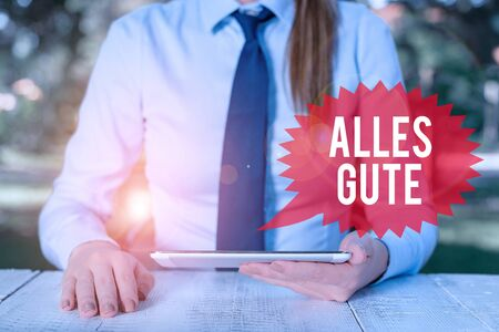 Word writing text Alles Gute. Business photo showcasing geranalysis translation all the best for birthday or any occasion Female business person sitting by table and holding mobile phone