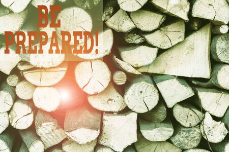 Text sign showing Be Prepared. Business photo showcasing try be always ready to do or deal with something Background dry chopped firewood logs stacked up in a pile winter chimney