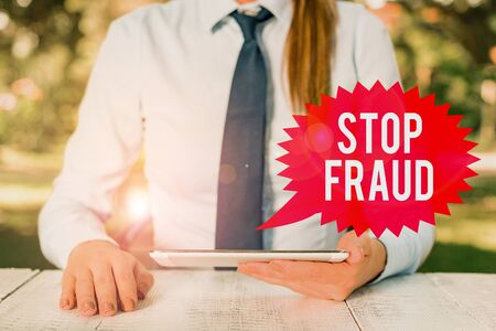 Word writing text Stop Fraud. Business photo showcasing campaign advices showing to watch out thier money transactions Female business person sitting by table and holding mobile phone
