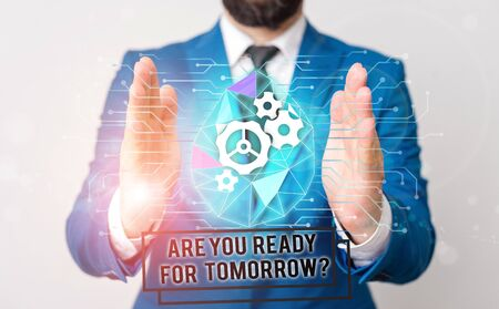 Handwriting text writing Are You Ready For Tomorrow Question. Conceptual photo Preparation to the future Motivation Male human wear formal work suit presenting presentation using smart device 版權商用圖片