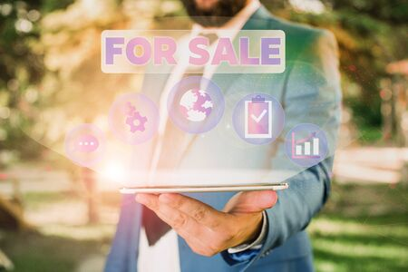 Text sign showing For Sale. Business photo showcasing putting property house vehicle available to be bought by others Male human wear formal work suit presenting presentation using smart device Фото со стока