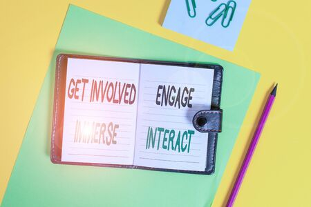 Conceptual hand writing showing Get Involved Engage Immerse Interact. Concept meaning Join Connect Participate in the project Locked diary striped sheets clips notepad colored background