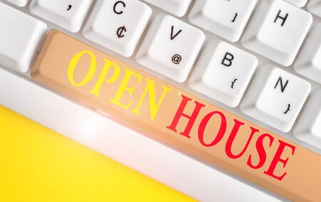 Conceptual hand writing showing Open House. Concept meaning you can come whatever whenever want Make yourself at home White pc keyboard with note paper above the white background