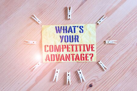 Writing note showing What S Your Competitive Advantage Question. Business concept for Marketing strategy Plan Colored clothespin papers empty reminder wooden floor background office