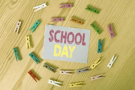 Handwriting text School Day. Conceptual photo starts from seven or eight am to three pm get taught there Colored clothespin papers empty reminder wooden floor background office