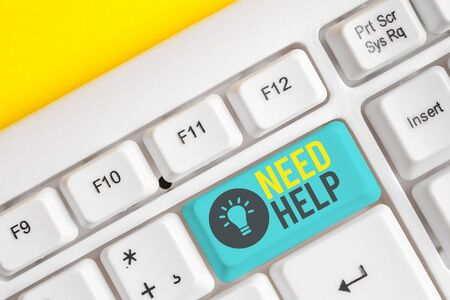 Conceptual hand writing showing Need Help. Concept meaning When someone is under pressure and cannot handle the situation White pc keyboard with note paper above the white background Фото со стока - 131364979
