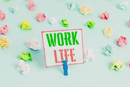 Word writing text Work Life. Business photo showcasing An everyday task to ern money to sustain needs of one s is self Colored crumpled papers empty reminder blue floor background clothespin