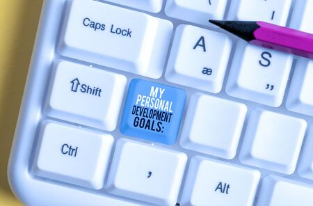 Conceptual hand writing showing My Personal Development Goals. Concept meaning Desires Wishes Career Business planning White pc keyboard with note paper above the white background Stok Fotoğraf - 131365025