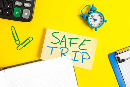 Text sign showing Safe Trip. Business photo showcasing wishing someone to reach his destination in good health Empty orange paper with copy space on the yellow table