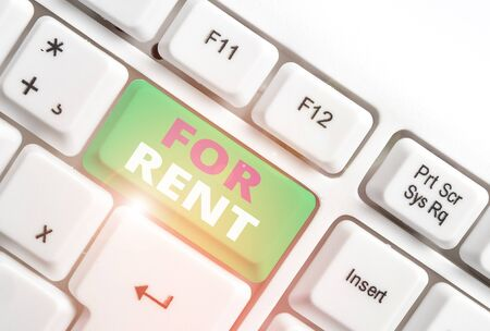 Word writing text For Rent. Business photo showcasing when you make property available for purchasing temporarily White pc keyboard with empty note paper above white background key copy space Фото со стока