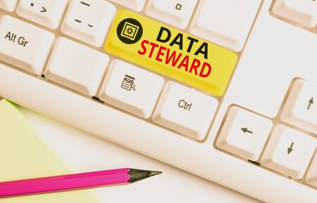 Text sign showing Data Steward. Business photo text responsible for utilizing an organization s is data governance White pc keyboard with empty note paper above white background key copy space