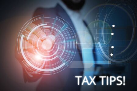 Writing note showing Tax Tips. Business concept for compulsory contribution to state revenue levied by government Male wear formal suit presenting presentation smart device Stok Fotoğraf