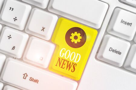 Conceptual hand writing showing Good News. Concept meaning Someone or something positive,encouraging,uplifting,or desirable White pc keyboard with note paper above the white background Фото со стока - 131365046