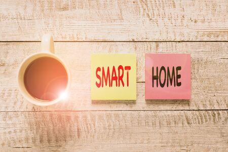 Handwriting text writing Smart Home. Conceptual photo automation system control lighting climate entertainment systems Stationary placed next to a cup of black coffee above the wooden table Фото со стока - 131365047