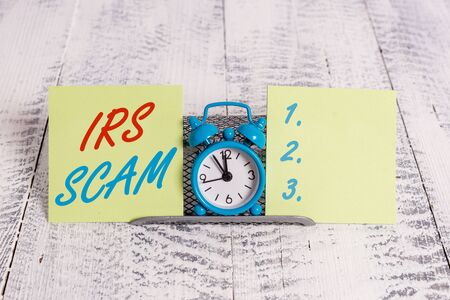 Handwriting text writing Irs Scam. Conceptual photo targeted taxpayers by pretending to be Internal Revenue Service
