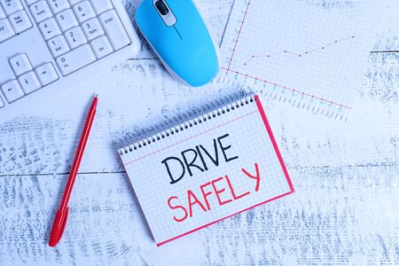 Conceptual hand writing showing Drive Safely. Concept meaning you should follow the rules of the road and abide laws Wood desk office appliance computer equipaments charts paper slot