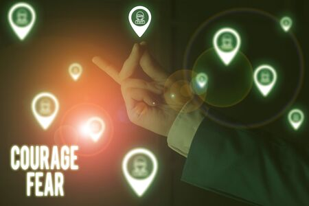 Text sign showing Courage Fear. Business photo showcasing quality of mind that enables a demonstrating to face difficulty Male human wear formal work suit presenting presentation using smart device