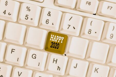 Word writing text Happy 2020. Business photo showcasing time or day at which a new calendar year begin from now White pc keyboard with empty note paper above white background key copy space Stockfoto