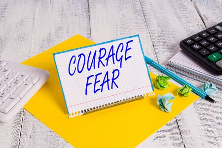 Handwriting text writing Courage Fear. Conceptual photo quality of mind that enables a demonstrating to face difficulty Stok Fotoğraf - 131365072