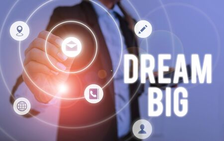 Writing note showing Dream Big. Business concept for To think of something high value that you want to achieve