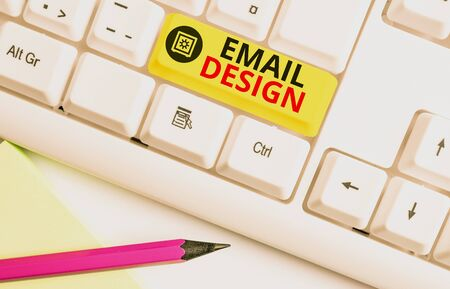 Text sign showing Email Design. Business photo text reusable HTML file that is used to build email campaigns White pc keyboard with empty note paper above white background key copy space