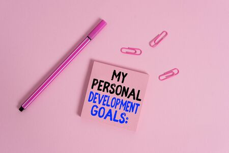Writing note showing My Personal Development Goals. Business concept for Desires Wishes Career Business planning Colored sticky note clips binders gathered pen trendy cool background